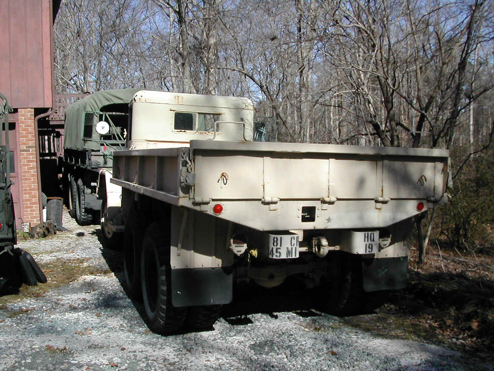 Photos of the 1967 Kaiser M35A2 on rear drive shaft, rear seat, rear lights, rear body harness,